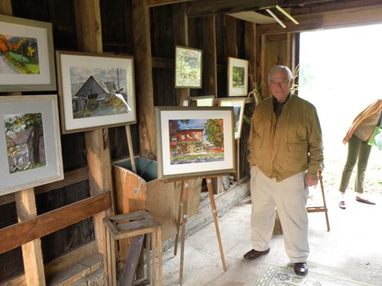 Tom McCobb with some of his paintings