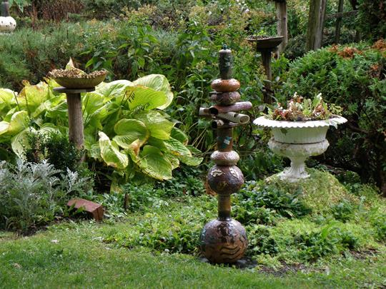 Ceramic sculptures by Naomi DeMuth in her own garden