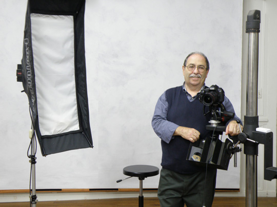 A photograph of the photographer, Gene Gissin, in his studio