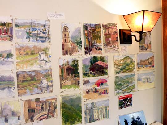 The wall of daily paintings at Mary Padgett's studio
