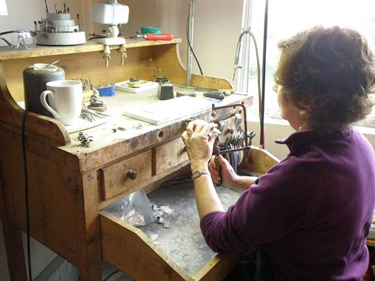 Susan Machamer demonstrating her jewelry making skills
