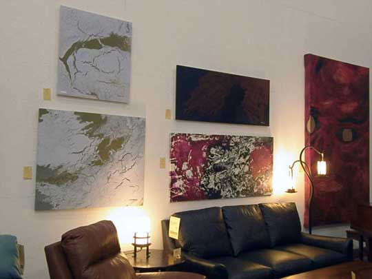Shawn Gilmore's large paintings on display at his furniture store