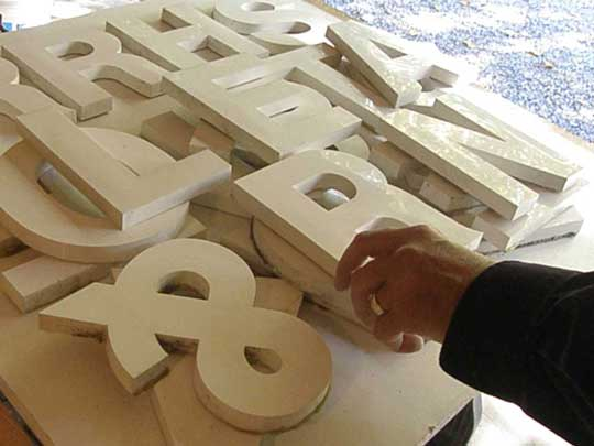 Hand-made letters by Paul Parpard ready for a custom-made sign