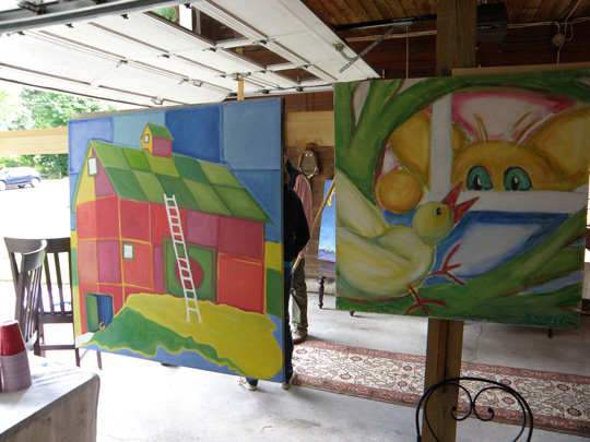 Vibrant paintings by Jennifer Hooley on display in the garage