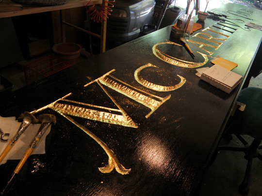 Paul Parpard's gold leaf work on his carved sign