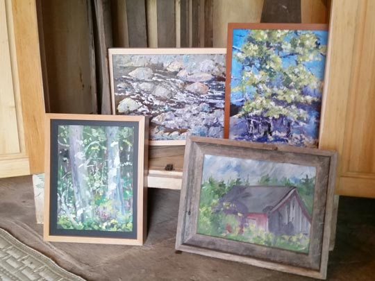 Several of Tom McCobb's paintings displayed in Tom's barn