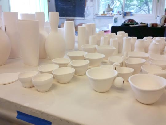 Ceramic vessels awaiting glazes in the Beasecker/Lurie studio